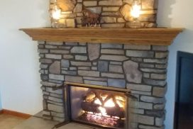 Fireplace gas log installation with a new fireplace door